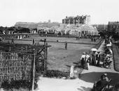 The bowling green at Alexandra Gardens Scarborough with the Floral Hall in the background
