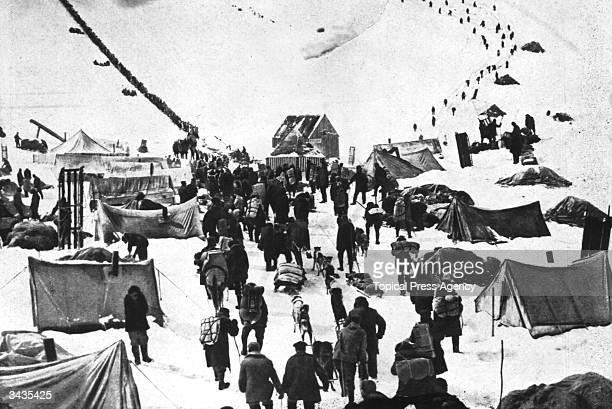 A caravan of prospectors arriving at the snowy wastes of the Klondike in Canada to join the great Gold Rush