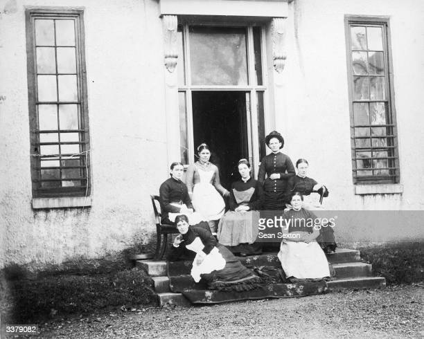 Domestic servants on the steps of a house in Ireland