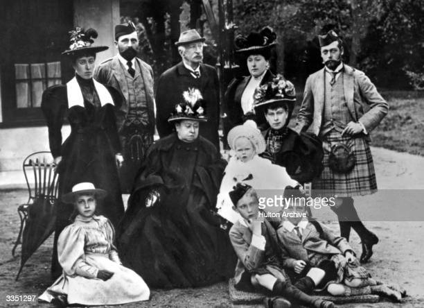 Queen Victoria with her family Princess Helena Victoria of SchleswigHolstein Prince Henry of Battenberg Count Arthur MensdorffPouilly Beatrice...