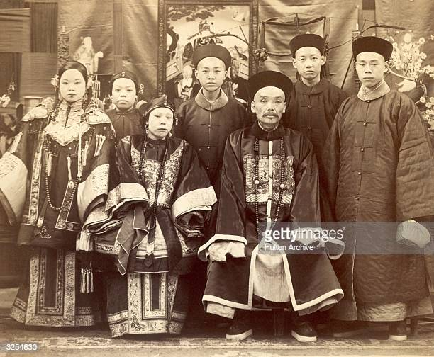 A Chinese mandarin with his wife and children