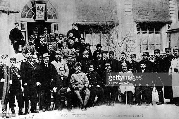 A group of international representatives for negotiations in the Boxer Rebellion outside a German Imperial Post Office