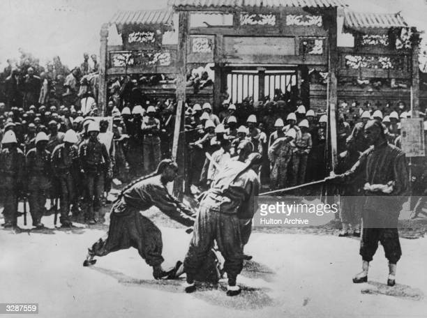 A public execution of a Boxer rebel in China during the Boxer Rebellion