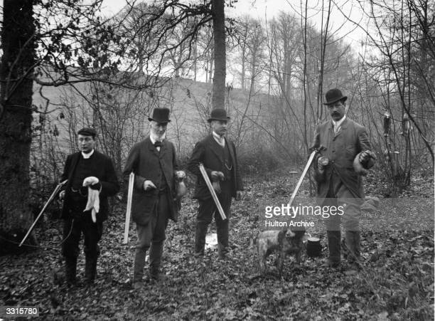 Four men on a rabbit shoot with ferrets to flush out their quarry from their burrows
