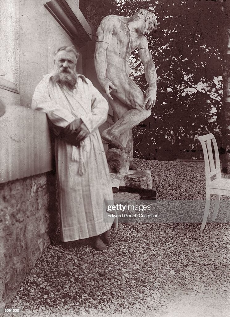 French sculptor Francois Auguste Rene Rodin in the garden of his villa at Meudon near Paris Behind him is the original plaster statue of 'The...