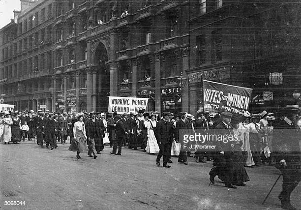 Male and female members of the women's suffrage movement on a protest march through London