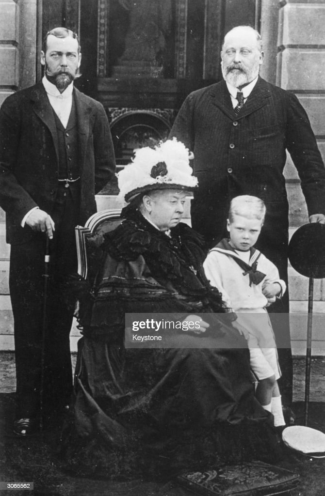 Queen Victoria (1819 - 1901) with her eldest son Prince Edward, Duke of Windsor (1841 - 1910, right), later King Edward VII and his son Prince George, Duke of York (1865 - 1936, left), later King George V. The small boy is George's son, the future King Edward VIII (1894 - 1972).