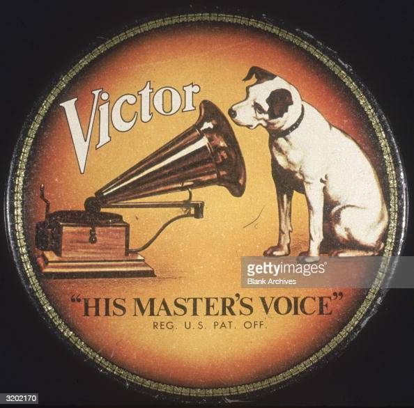 Record label logo for Victrola RCA Victor showing the dog Nipper looking into the horn of a Victrola The label's slogan reads 'His Master's Voice'