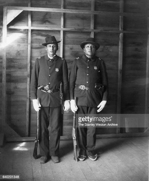 Red Tomahawk and Eagle Man both Yanktonai Sioux at Standing Rock Reservation of the Dakota Indian Police pose for a portrait circa 1900