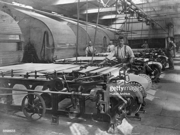 A factory worker preparing the warp for the loom at Horrocks's Crewdon Co Preston 'the greatest cotton mills in the world'