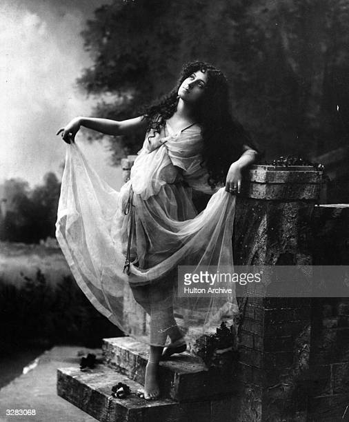 An Edwardian woman poses in a fantasy garden