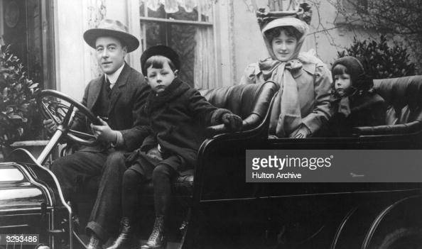 English comedian Sir George Robey goes motoring with his family