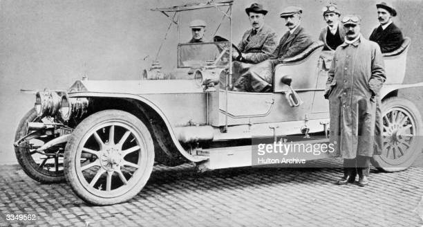 Claude Johnson at the wheel of a famous Rolls Royce classic the six cylinder Silver Ghost which achieved a world record in 1907 by driving 14371...