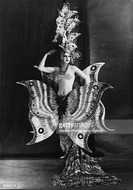 A cabaret dancer wearing a fantastic butterfly costume at the Folies Bergere theatre Paris