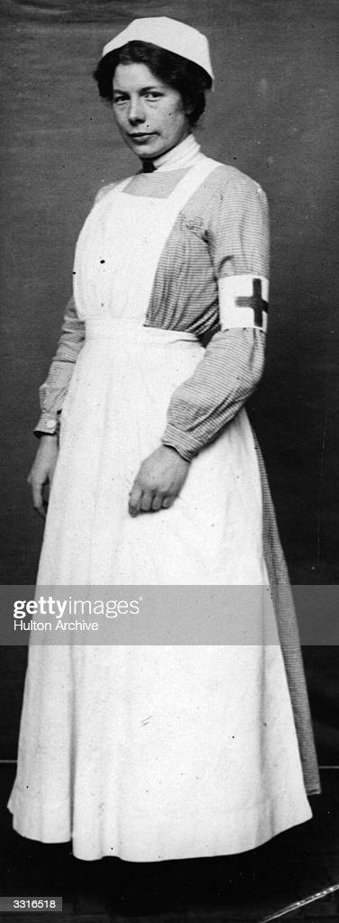 A Red Cross nurse in uniform.