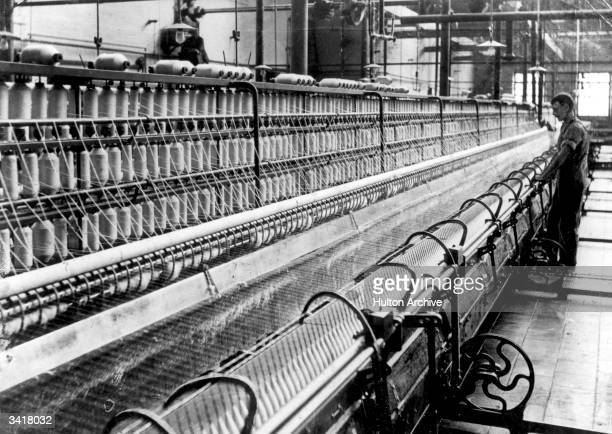 An industrial loom capapble of spinning and winding four thousand miles of thread a day in use at Horrocks' Crewdon and Co Mill Preston Lancashire