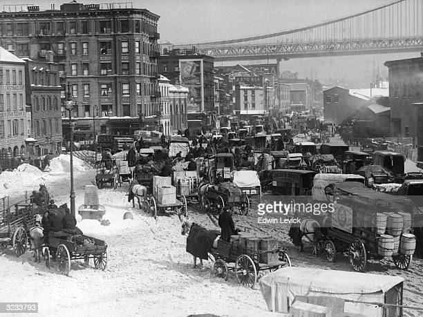 Congested traffic on a main thoroughfare in Brooklyn New York City looking west toward Manhattan Bridge over the East River