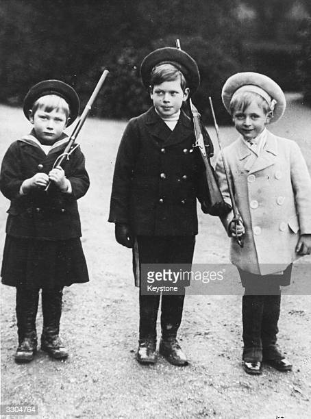 From left Prince John and Prince George two of King George V's children and their cousin Prince Olav son of King Haakon VII of Norway and Queen Maud
