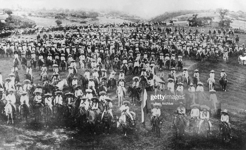 Mexican revolutionaries Pancho Villa and Emiliano Zapata assemble with their army of peasants and farmers on horseback Mexico
