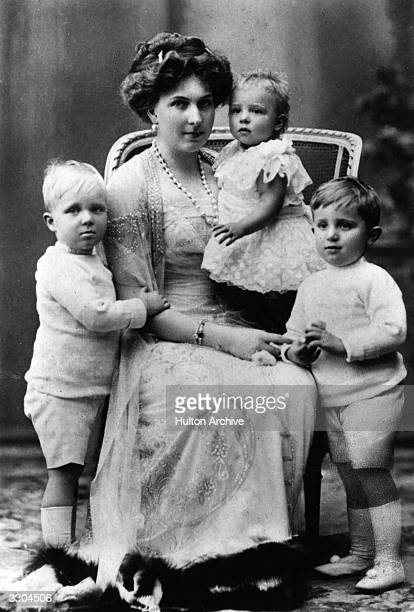 Queen Victoria Eugenie of Spain wife of King Alfonso XIII of Spain whom she married in 1906 with her children From left Prince Alfonso Princess...
