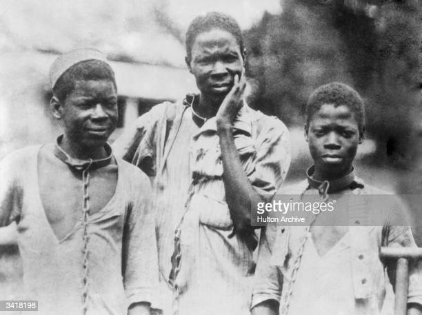 Three Abyssinian slaves in iron collars and chains