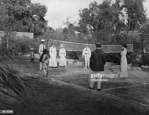 A game of badminton in progress in a garden on Monzong Road India