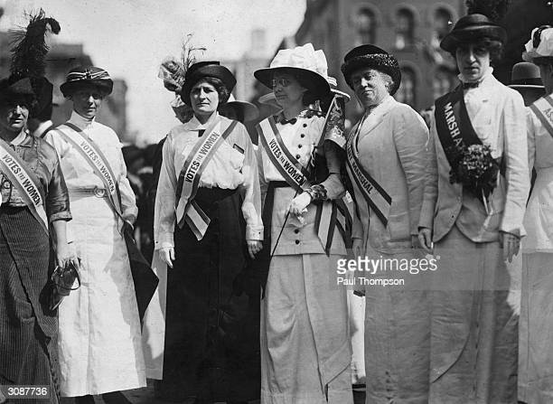 From left to right Inez Haynes Gillmore Hildegarde Hawthorne Edith Ellis Furness Rose Young Katherine Licily and Sally Splint represent female...