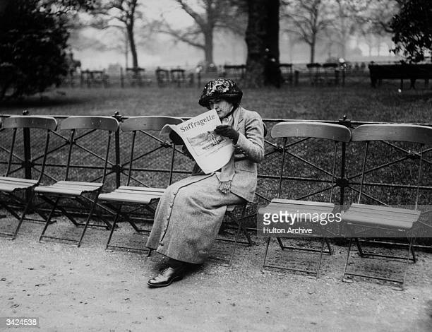 In a photograph specially taken for the 'Suffragette' paper a woman sits engrossed in the 'Suffragette'