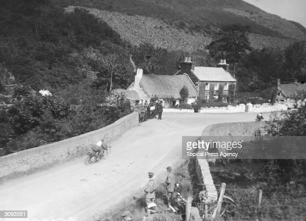 T Thomas Jnr on a Douglas approaching Ballig Bridge during the Isle of Man TT Race