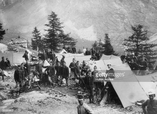 A group of Alpine Infantry soldiers camped at the foot of Mount Vilau in the Italian Alps during World War I