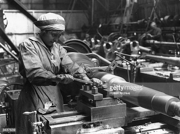 A woman at work in an armaments factory
