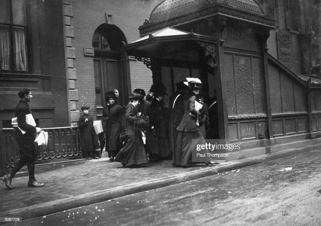 A group of suffragettes enter the New York subway to catch the 'penny tube' to Wall Street.