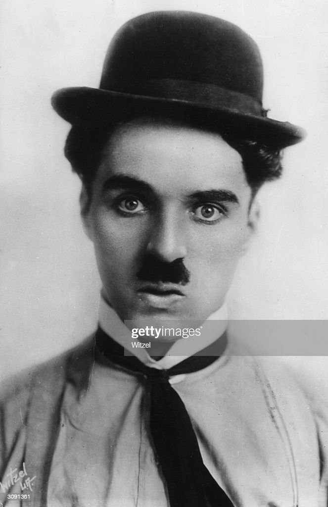 Film star and director <a gi-track='captionPersonalityLinkClicked' href=/galleries/search?phrase=Charlie+Chaplin&family=editorial&specificpeople=70006 ng-click='$event.stopPropagation()'>Charlie Chaplin</a> (1889 - 1977). He was knighted in 1975.