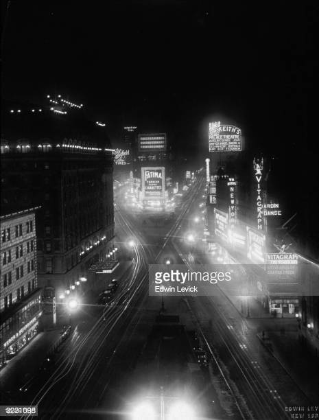 Highangle view of Times Square at night looking north with neon lit commercial signs and theater marquees New York City Marquees for the Vitagraph...