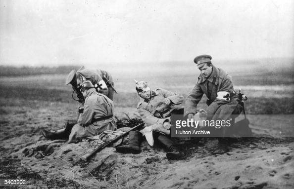 Red Cross personnel attending to wounded soldiers on a Russian battlefield during the First World War