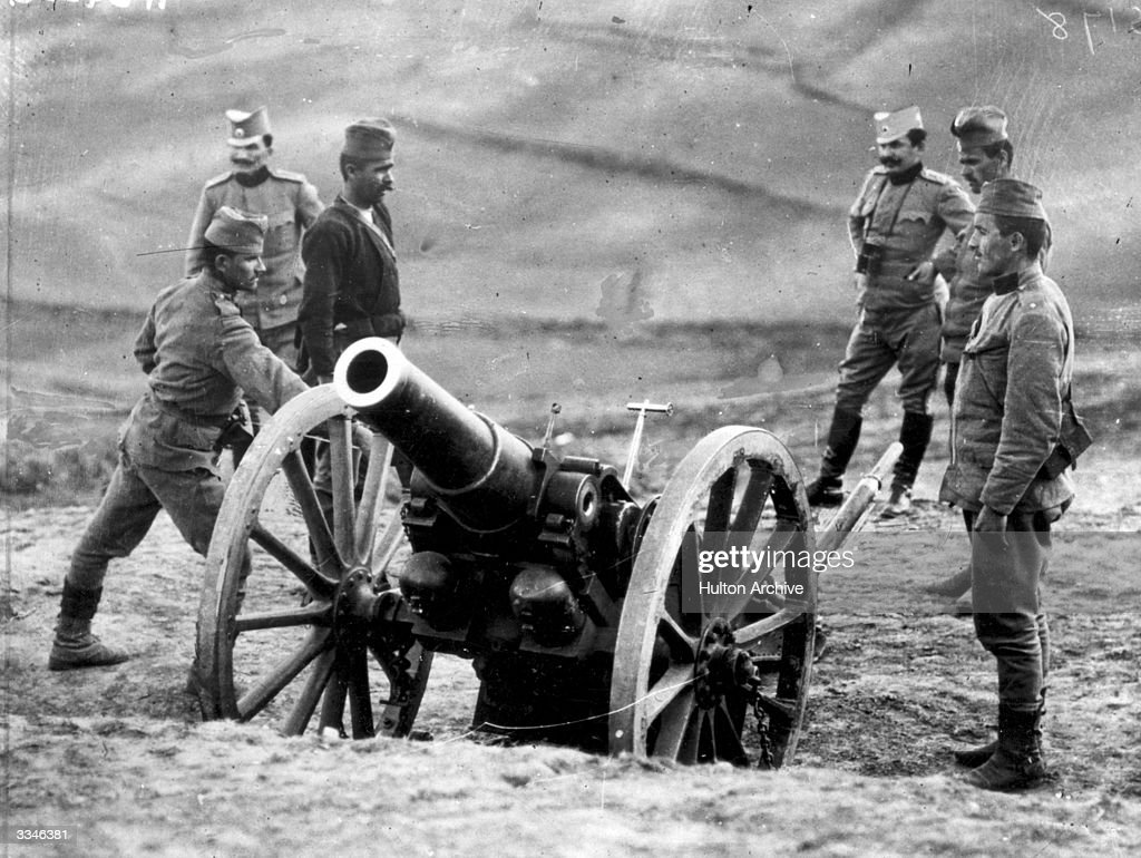 Serbian officers with a Howitzer battery as they prepare to fire on Austrians during the First World War
