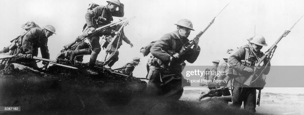 Canadian soldiers charging over the top.