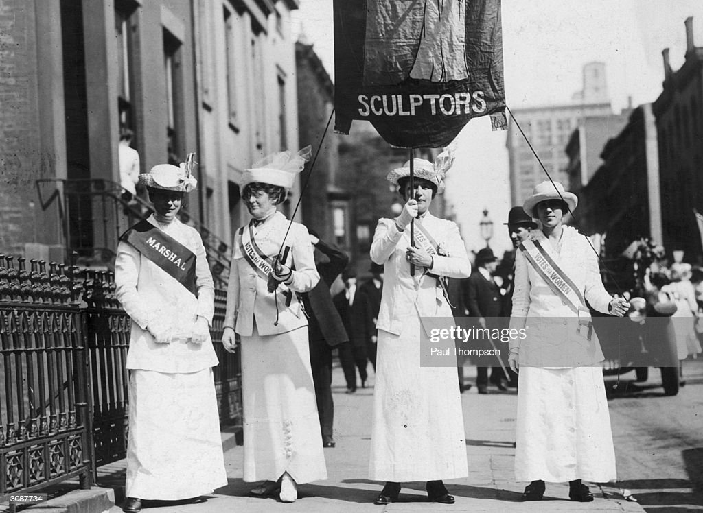 From left to right, sculptors Frances Grimes, Mrs G Converse, Mrs Cleo Bracken and Frances Burr campaign for votes for women on a Women's Suffrage Parade in New York City.