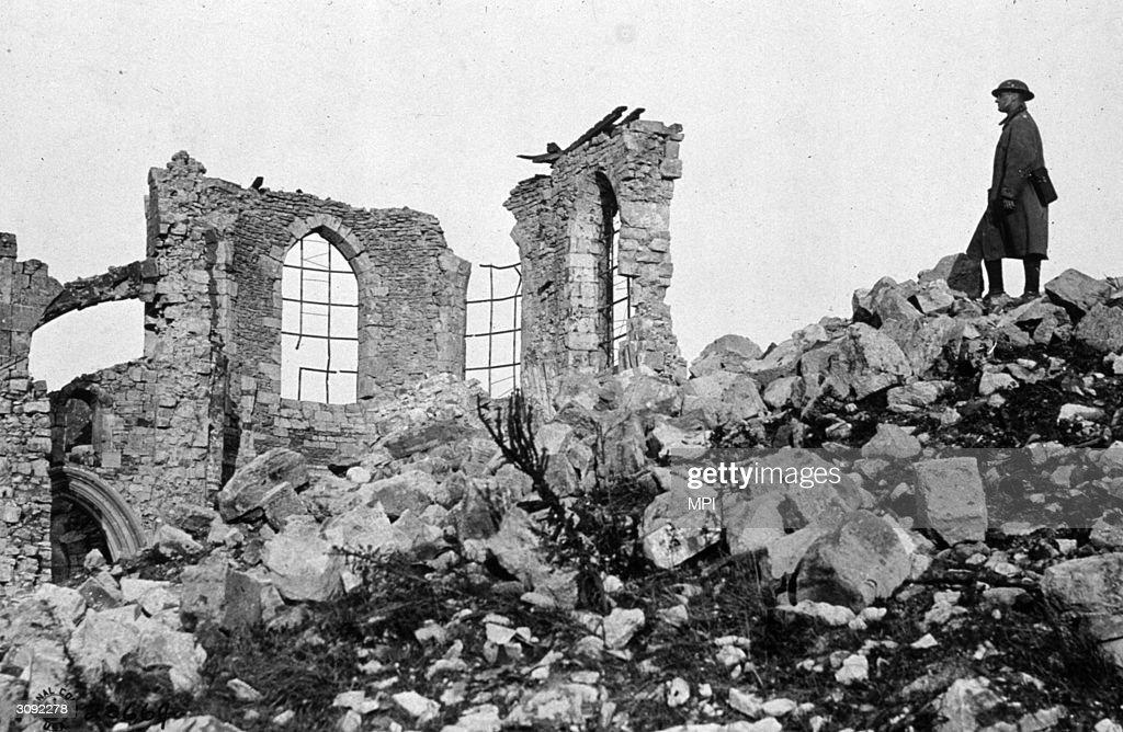An American soldier in the ruins near Verdun, France.