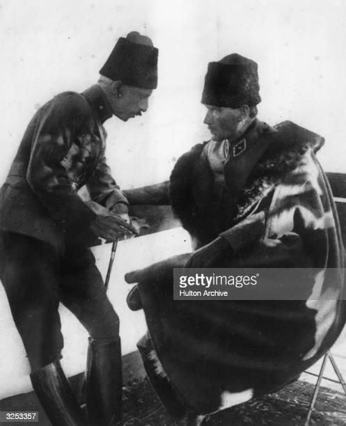 Tenfik Pasha and Kemal Pasha deep in conversation