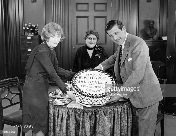 American actress Marion Davies left presents a birthday cake to Mr and Mrs Hobart