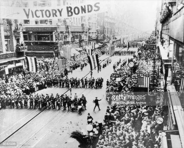 View looking north of a crowd of people on Broadway and Fifth at the Homecoming Parade of the 364th Infantry after World War I Los Angeles California...