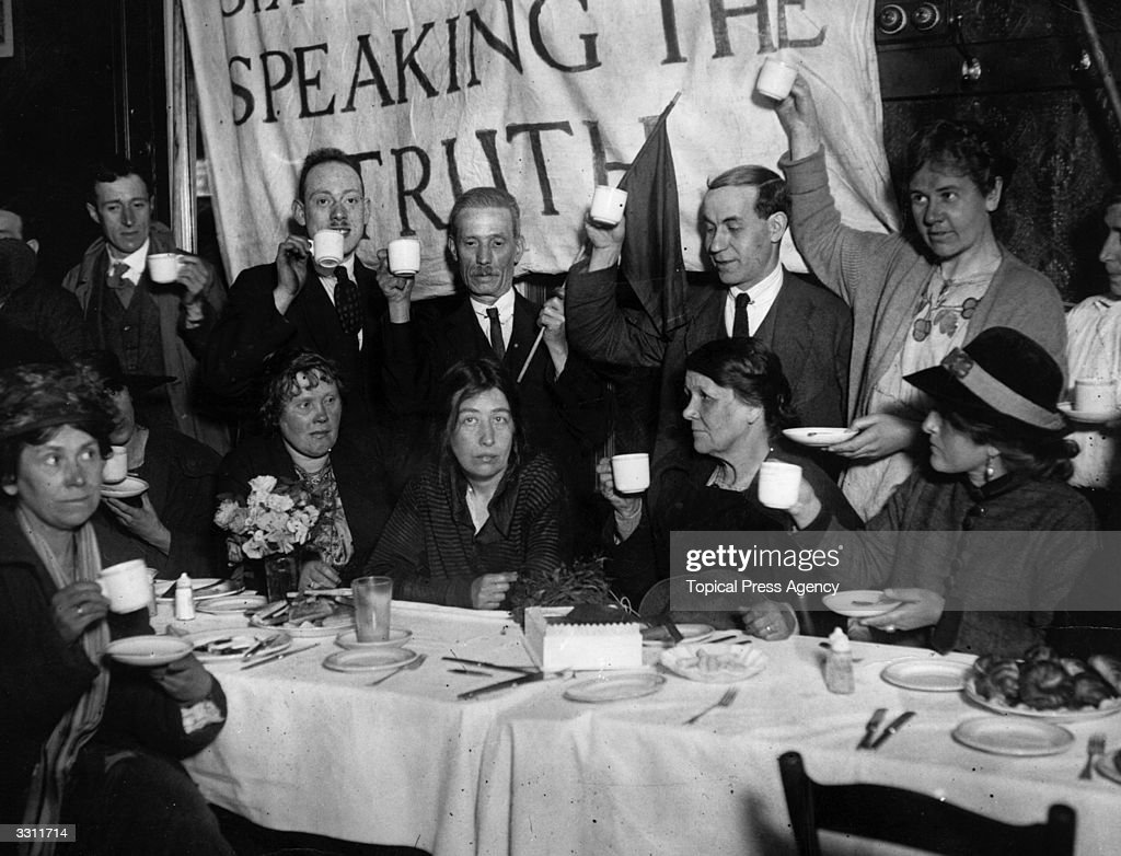 Recently released from prison, militant suffragette leader Sylvia Pankhurst is toasted at a celebration breakfast in East London.