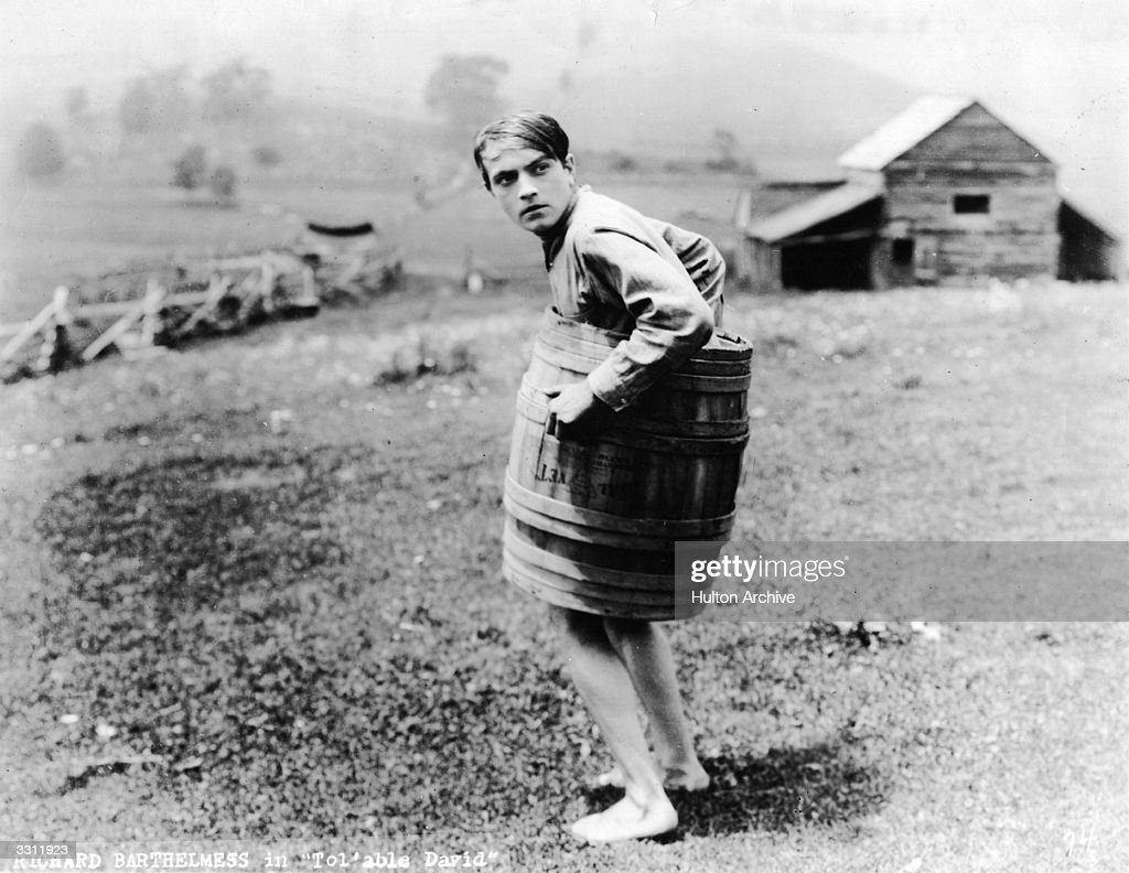 Richard Barthelmess trouserless and covering his modesty with a barrel in the film 'Tol'able David'.