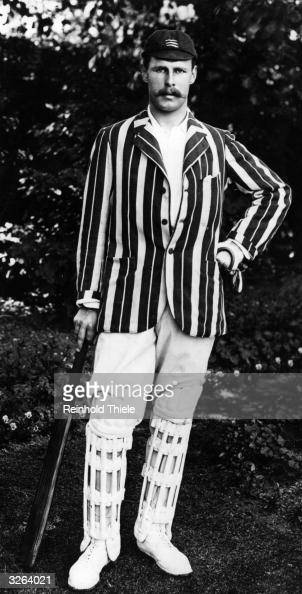 The cricketer Hayman sporting a striped blazer and leg pads