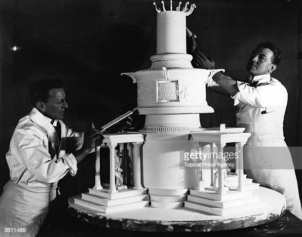 An elaborately decorated cake built by Messrs Bowen and Atkins presented by the National Association of Bakers