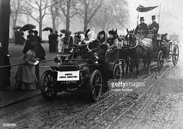 Four members of the Women's Suffrage Movement in a car at a demonstration