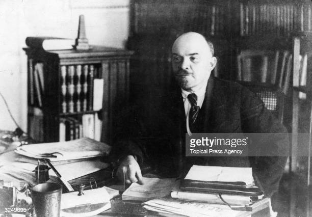 Russian revolutionary Vladimir Ilyich Lenin in his office