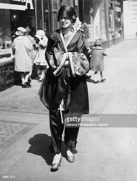 Jean Wilson gives the Easter parade on Fifth Avenue a novel touch appearing in her modified Japanese pyjamas