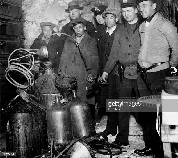 A raid on a basement in Mulberry Street New York where a group of Orientals were suspected of making hooch during Prohibition